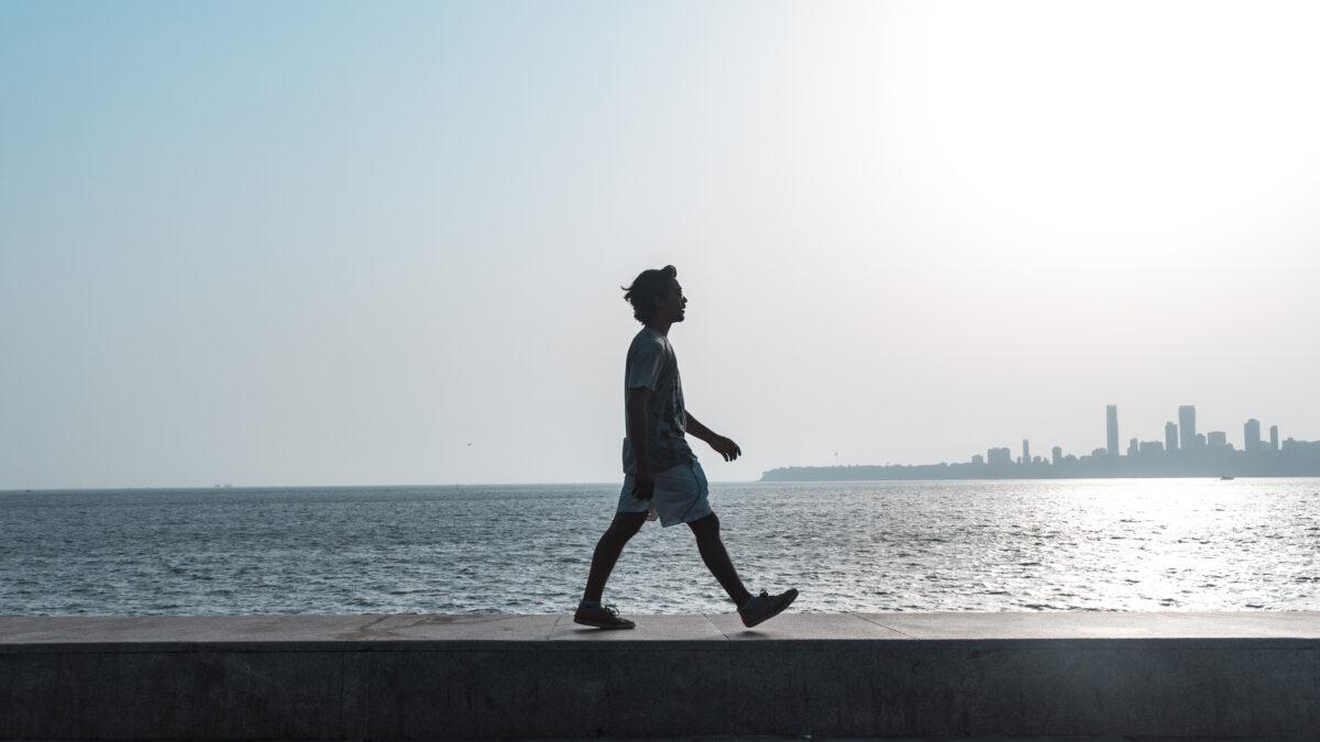 Man walking near water